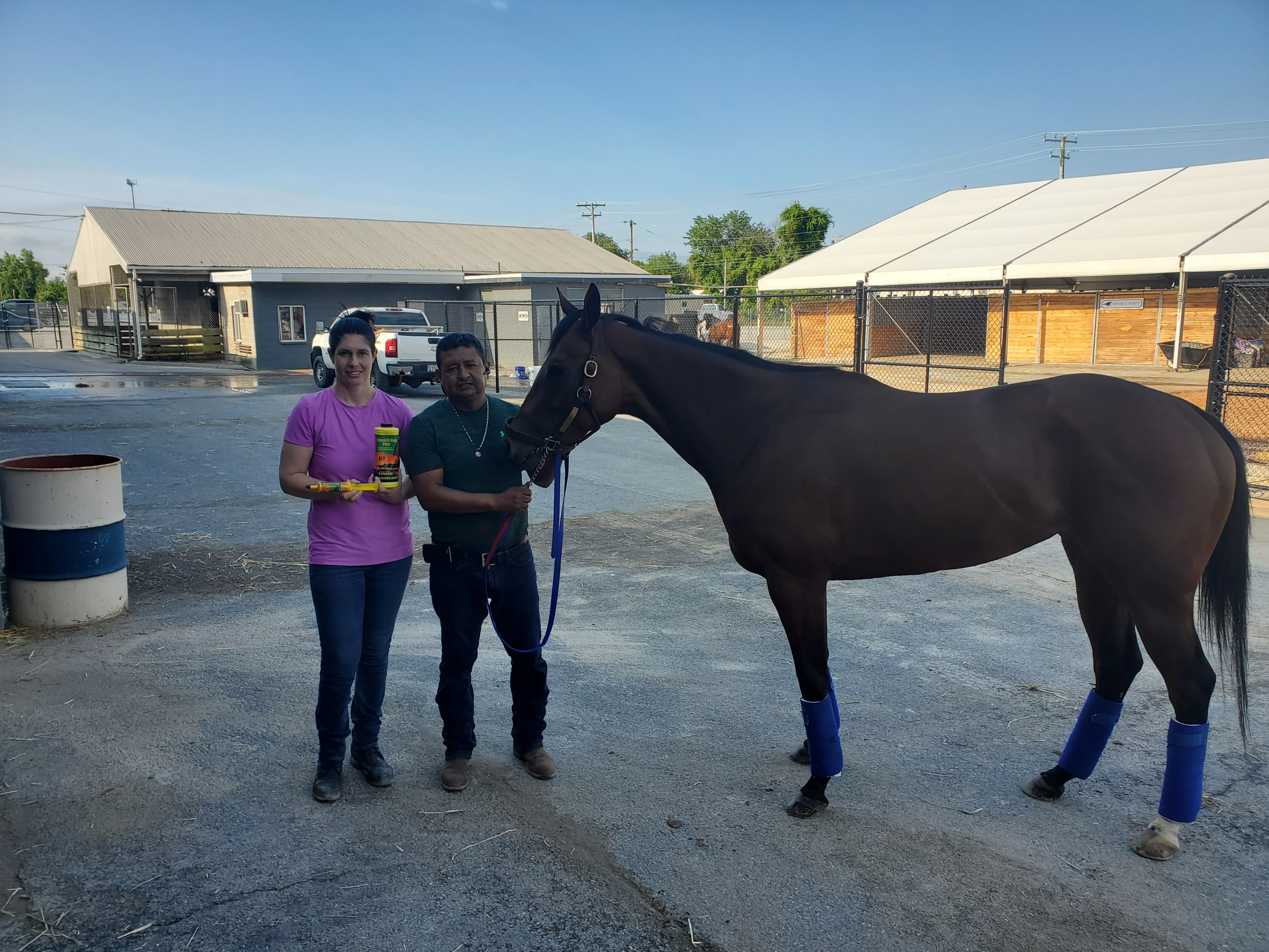 Joanne Shankle and Rudy Sanchez with a Thoroughbred